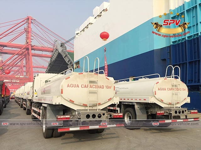 50 units of water tankers are parked on the port yard, just besides the vessel